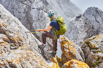woman climbing in mountains of Austria / Extreme Sports in the Alps