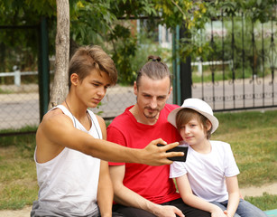 father and two sons posing for photo selfie