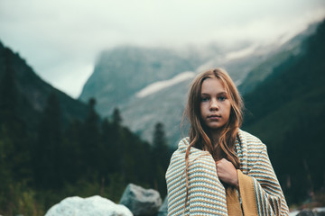 Girl wrapped in blanket