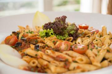 Rigatoni with tomato sauce and salad