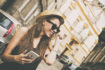 Attractive woman using cellphone outdoors.