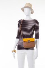 Striped top and beige hat.