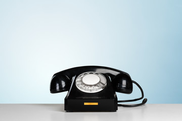 Retro black telephone on table
