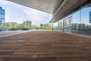Fototapete - Empty wooden footpath front modern building