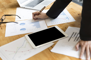 businessman in suit analyze market analysis business chart with