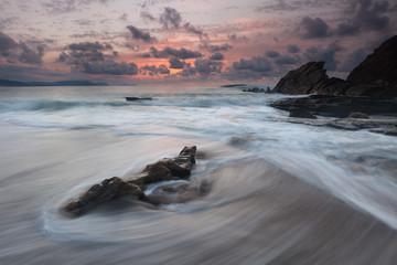 Beautiful sunset in Azkorri beach (Bizkaia, Basque Country)