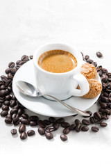 cup of fresh espresso and cookies on white background, vertical