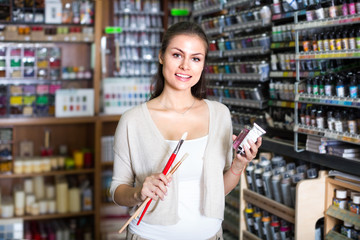 woman choosing paint color in tube