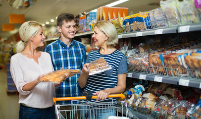 Happy family looking at assortment of bread