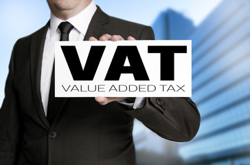 vat sign is held by businessman