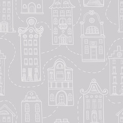 Seamless pattern of hand-drawn and colored houses.