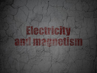 Science concept: Electricity And Magnetism on grunge wall background