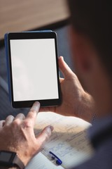 Mature student using digital tablet