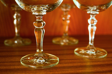 Empty glassware for wine. Beautiful stemglass with decoration and ornaments. Highlighting of contours and shape of glass. Soft selective focus