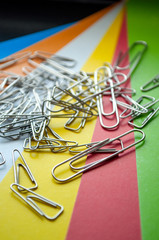 Metal clips on colored paper