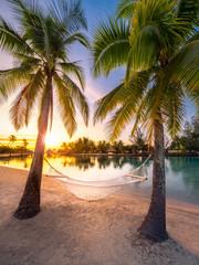 Wall Mural - Urlaub am Strand in der Karibik bei Sonnenuntergang