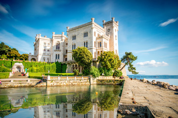 View on Miramare castle on the gulf of Trieste on northeastern Italy. Long exposure image technic with reflection on the water Fototapete