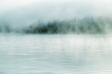 Foto auf Acrylglas See / Weiher Heavy fog in the early morning on a mountain lake Early morning on Yazevoe lake in Altai mountains, Kazakhstan