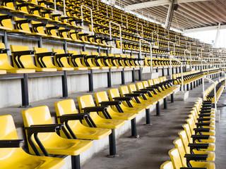 Foto op Plexiglas Stadion empty yellow seats
