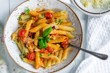 Penne pasta and arrabbiata sauce with cherry tomatoes