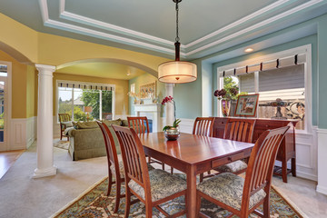 Dining room interior with mint walls and coffered ceiling.