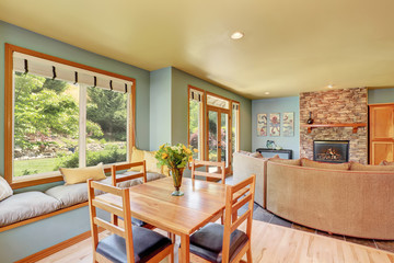 Dining area with wooden table set and cozy sitting place.