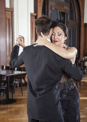 Woman Closing Eyes While Performing Tango With Man