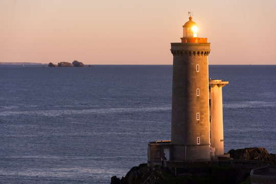 Lighthouse in the Atlantic ocean at sunset