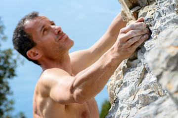 Man climbing on limestone