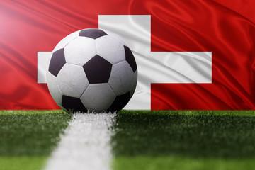 soccer ball against Switzerland flag