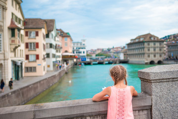 Adorable little girl outdoors in Zurich, Switzerland. Back view of beautiful kid background of cute city