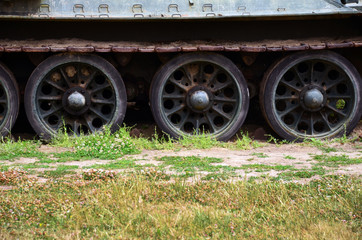 Detail of wheels and tread of vintage tank