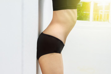 beautiful fitness model measures the waist on white background,h