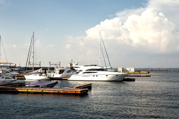 Sea pier with many yachts