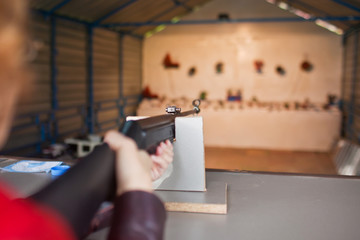 Woman shoots a gun at a shooting range