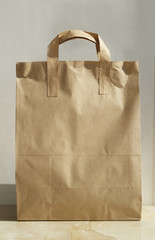 Paper bag over white wall