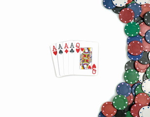 Four of a kind poker combination and chips. Isolated