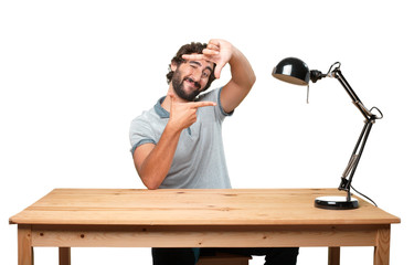 crazy young man with table .happy expression