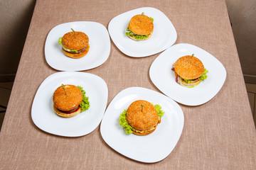 Set of five big and tasty hamburgers