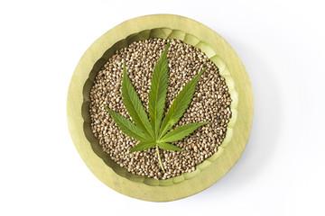marijuana green leaf symbol raw hemp seeds close up
