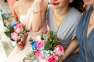 Look from above on beautiful bridesmaids holding wedding bouquet