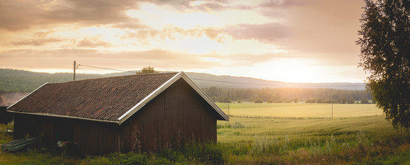 Farm in Nordic countries and sunset Wall mural