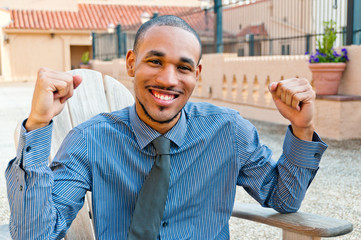 Smiling Young Handsome Millenial Black Man with Victory Gesture