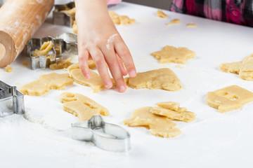 Children's hands knead the dough for baking cookies