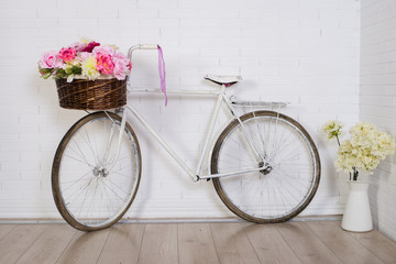 retro bicycle with basket in front of the old brick wall, background