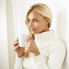 Beautiful  blond hair woman joying in hot coffee