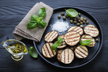 Grilled aubergine with capers, sea salt, basil and olive oil