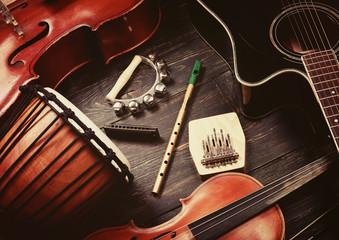Set of musical instruments on dark wooden background