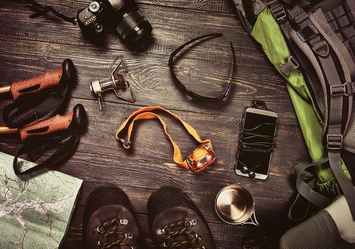 Hikking accessories set on dark wooden background