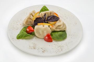Georgian dumplings with greens